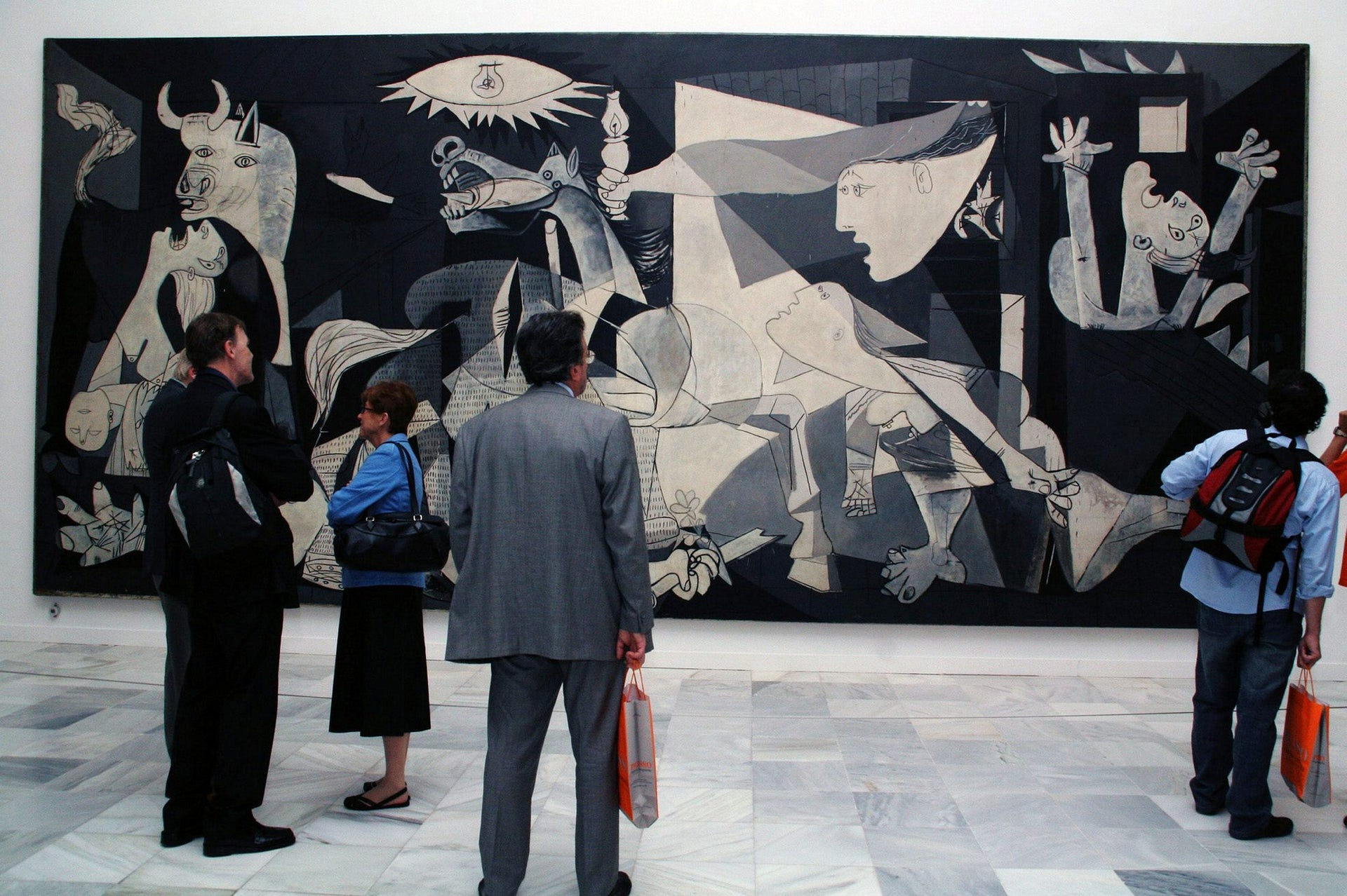 """People viewing Pablo Picasso's """"Guernica"""" at the Reina Sofia Museum in Madrid, 2006."""
