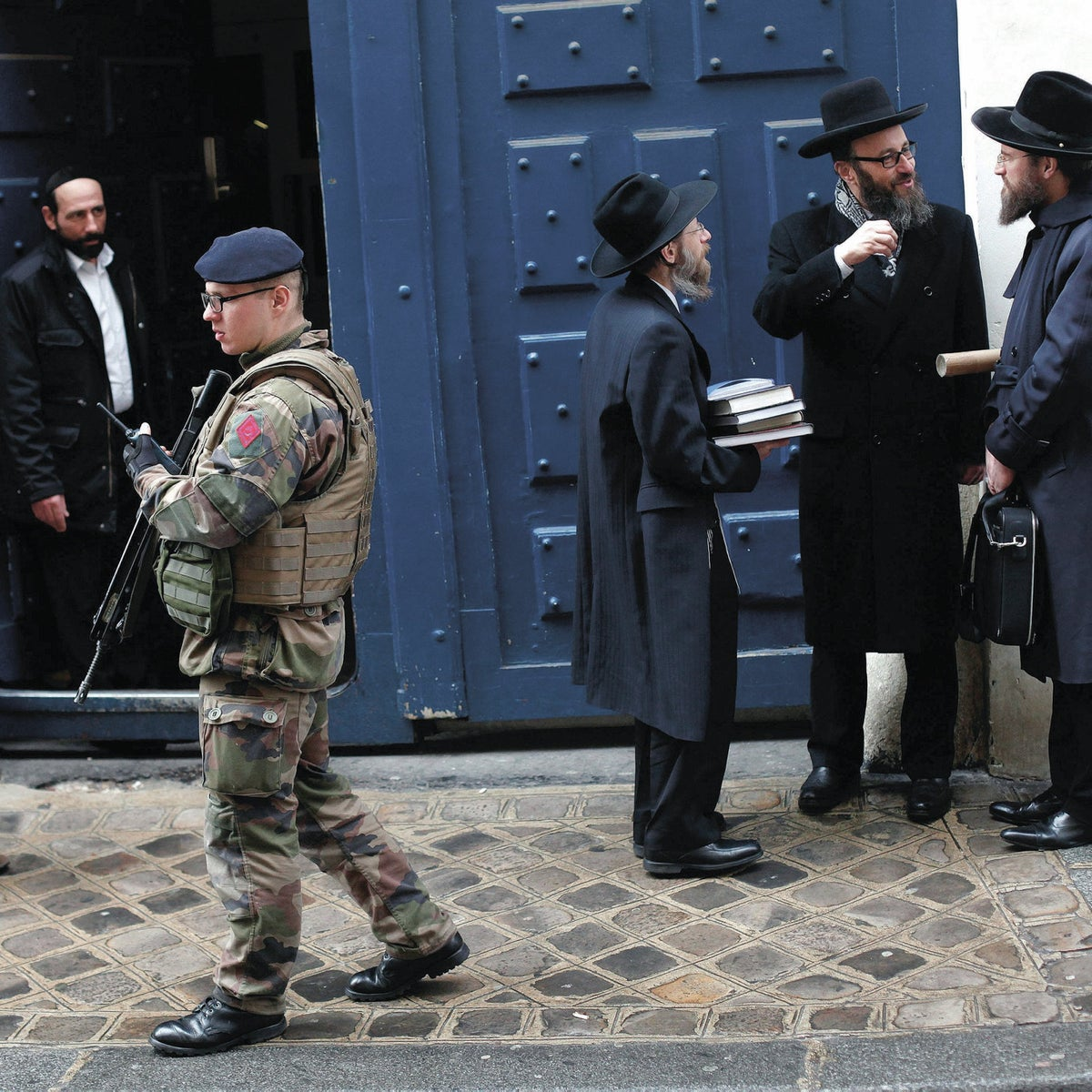 A French soldier patrols next to a Jewish school, in Paris, following three days of bloodshed in the city, Jan. 13, 2015.