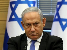Prime Minister Benjamin Netanyahu reacts during a meeting of the right-wing bloc at the Knesset in Jerusalem on November 20, 2019.