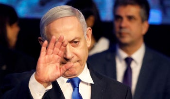 Israeli Prime Minister Benjamin Netanyahu waves after addressing members of his right-wing party bloc at a conference in Tel Aviv, Israel November 17, 2019.