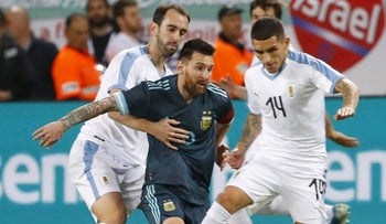 Argentina's Lionel Messi fights for the ball during the friendly football match between Argentina and Uruguay at the Bloomfield stadium in Tel Aviv, on November 18, 2019.