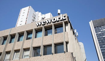A WeWork logo is seen outside an office space in Tel Aviv, August 27, 2019.