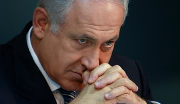 Israel's Prime Minister Benjamin Netanyahu attends a news conference in his office in Jerusalem on April 23, 2009.