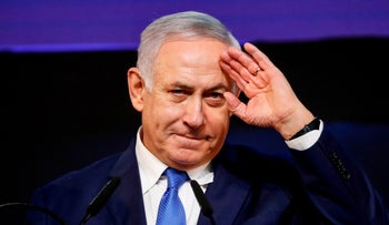 Israeli Prime Minister Benjamin Netanyahu gestures as he addresses supporters at his Likud Party headquarters in Tel Aviv, April 10, 2019.
