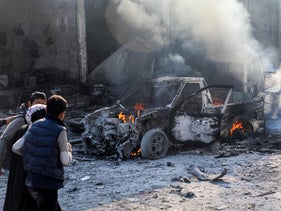A burning car following a car bomb explosion at the industrial zone in the northern Syrian town of Tal Abyad, on the border with Turkey, on November 23, 2019.