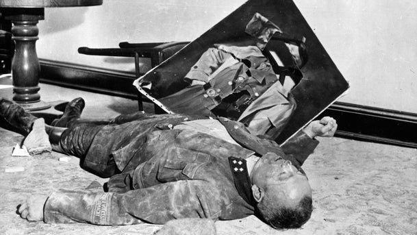 Volkssturm officer Walter Doenicke lies on the floor of city hall in Leipzig, Germany after committing suicide, April 19, 1945.