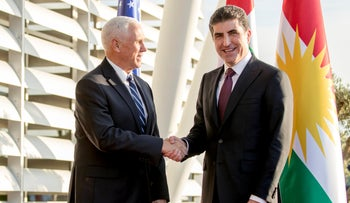 Vice President Mike Pence is greeted by Iraqi Kurdish Region President Nechirvan Barzani, right, at Erbil International Airport in Erbil, Iraq, Saturday, November 23, 2019.