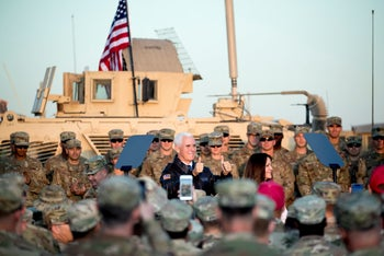 Vice President Mike Pence and his wife Karen Pence arrive to speak to troops at Erbil International Airport in Erbil, Iraq, Saturday, Nov. 23, 2019.
