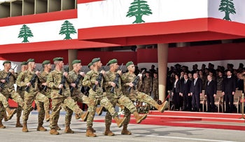Lebanese army soldiers march during a parade commemorating the anniversary of Lebanese independence from France at the Defense Ministry headquarters, November 22, 2019.
