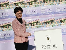 Hong Kong Chief Executive Carrie Lam casts her vote during the district council elections in Hong Kong, November 24, 2019.