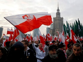People hold flags during a march marking the 101st anniversary of Polish independence in Warsaw, Poland November 11, 2019