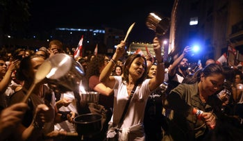Lebanese protesters bang on pots and pans during an anti-government demonstration in the capital Beirut, 06 November 2019.