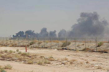Smoke billows from an Aramco oil facility in Abqaiq in Saudi Arabia's eastern province, September 14, 2019.