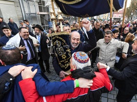 Members of the Jewish community walk and dance on the way to the dedication of the new synagogue in Konstanz, southern Germany. Nov. 10, 2019