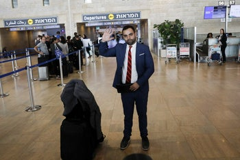 Omar Shakir waves as he makes his way to departures at Ben Gurion airport, Lod, Israel, November 25, 2019