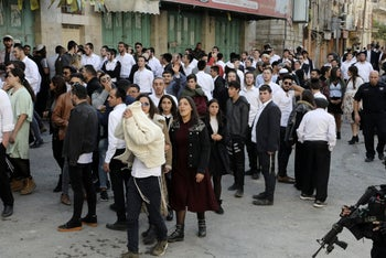 A group of Israeli Jews in the divided West Bank city of Hebron, November 23, 2019.