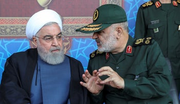Hassan Rohani (L) listens to General Hossein Salami in front of the shrine of Ayatollah Khomeini, just outside Tehran, Iran, September 22, 2019
