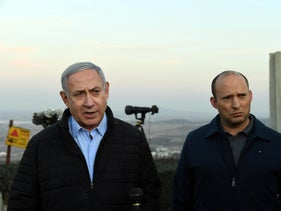 Prime Minister Benjamin Netanyahu and Defence Minister Naftali Bennett visit an army base in the Golan Heights overlooking Syrian territory, on November 24, 2019.