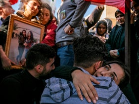 Friends and relatives of two victims of a triple bombing in the northeastern city of Qamishli, attend their funeral on November 13, 2019.