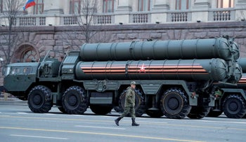 A Russian serviceman walks past S-400 missile air defense systems in Tverskaya Street in central Moscow, Russia, April 29, 2019.