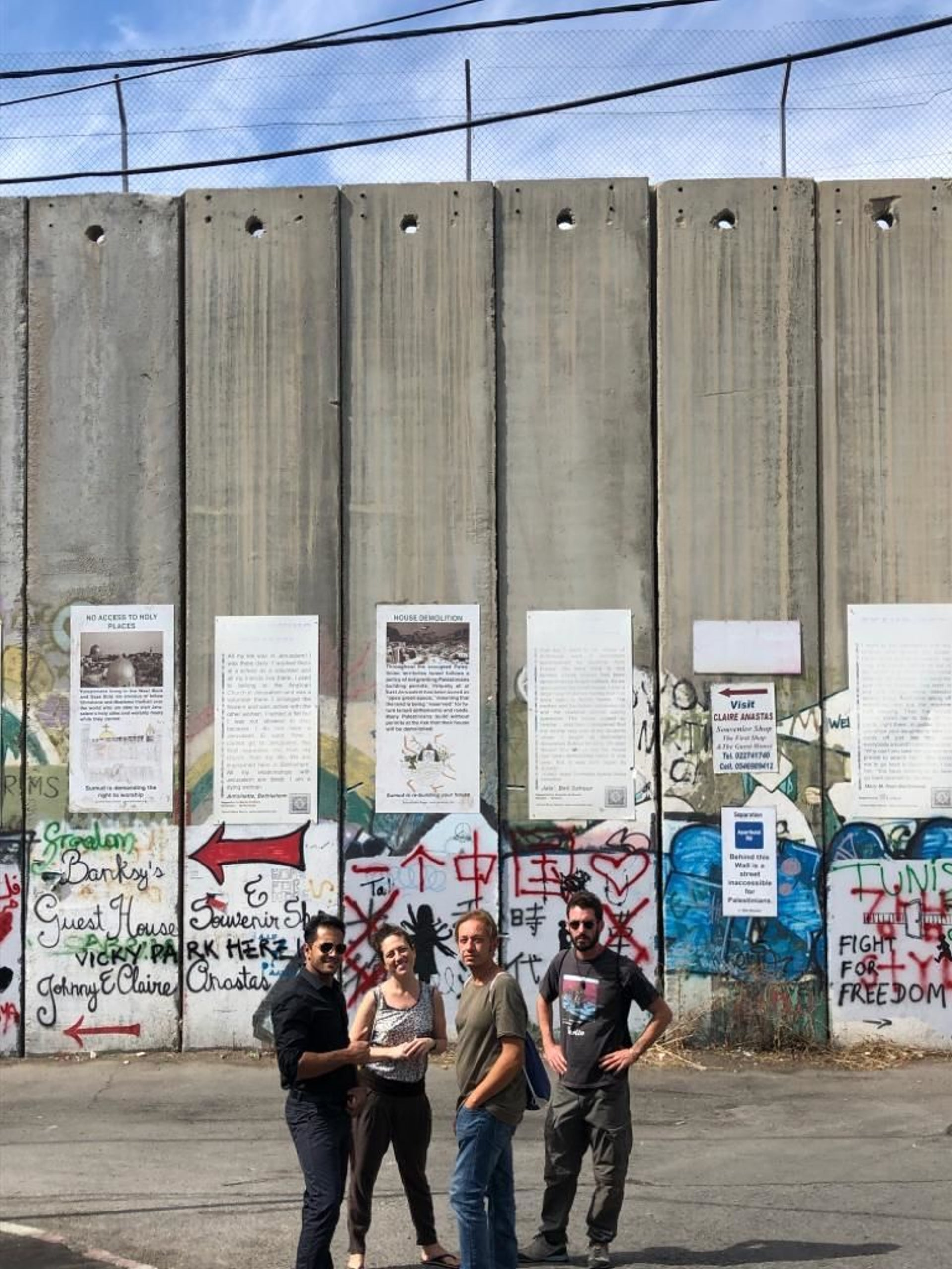 WISH YOU WERE HERE? Ahmad Nader Alfararja showing tourists the sights at the West Bank separation barrier.