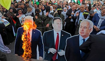 Palestinians burn cutouts of U.S. President Donald Trump, State Secretary Mike Pompeo, and Prime Minister Benjamin Netanyahu in 'day of rage' protests across the West Bank, November 26, 2019.
