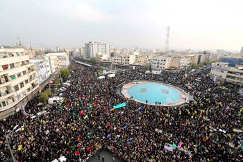 Iranian pro-government demonstrators gather in the capital Tehran's central Enghelab Square, November 25, 2019.