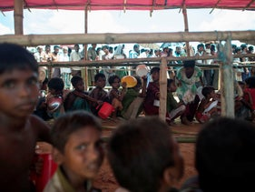 Rohingya Muslim refugees line up to receive food at a distribution area at Balukhali refugee camp near the town of Gumdhum in Cox's Bazar, October 1, 2017.