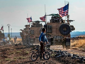 U.S. armored vehicles patrolling fields near the northeastern Syrian town of Qahtaniyah near the Turkish border, October 31, 2019.