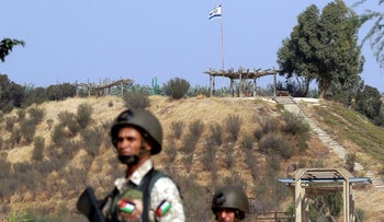 Jordanian soldiers stand guard near the border with Israel, at Baqura, east of the Jordan River, on November 13, 2019
