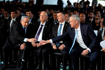 Kachol Lavan chief Benny Gantz shakes hands with Prime Minister Benjamin Netanyahu as President Ruvin Rivlin and Knesset Speaker Yuli Edelstein look on, at the state memorial ceremony for Yitzhak Rabin. Nov 10, 2019