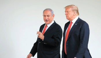 President Donald Trump and Prime Minister Benjamin Netanyahu walk along the Colonnade of the White House in Washington, August 21, 2019.