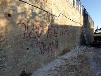 'Closed-off military area Kumi Ori hill'  scrawled on the walls of  the Palestinian village of Taybeh, November 29, 2019.
