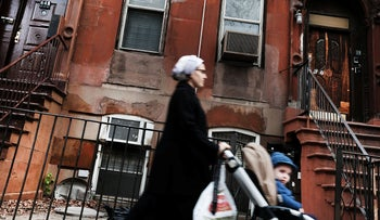 A Hasidic woman walks through a Jewish Orthodox neighborhood in Brooklyn on April 24, 2017 in New York City.