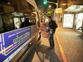 A passenger boards free weekend shuttle service in Tel Aviv, November 22, 2019.