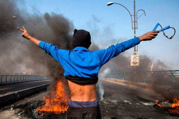 An Iraqi demonstrator gestures during a general strike and roadblocks in the southern city of Basra, on November 26, 2019
