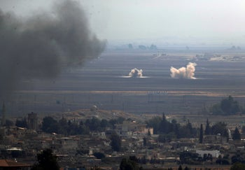 Smoke billows from targets in Ras al-Ayn, Syria, caused by bombardment by Turkish forces, Wednesday, Oct. 16, 2019