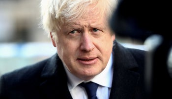 Britain's Prime Minister Boris Johnson speaks to the media at the scene of a stabbing on London Bridge, in which two people were killed, in London, Britain, November 30, 2019