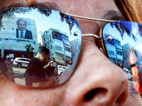 Sunglasses reflect people attending a rally against Prime Minister Benjamin Netanyahu outside the Likud party headquarters in Tel Aviv on November 22, 2019.