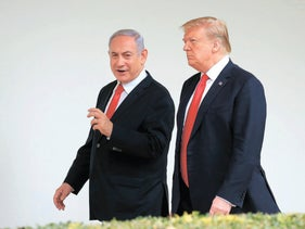 U.S. President Donald Trump and visiting Prime Minister Benjamin Netanyahu walk along the Colonnade of the White House in Washington, onMarch 25, 2019.