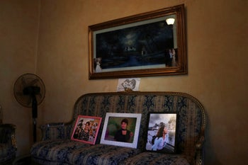 The family of Nadyn Jouny displays photos of her, at a 40-day mourning ceremony of her death, at their family house in southern Beirut, Lebanon, November 17, 2019.