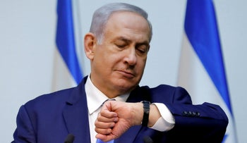 Benjamin Netanyahu gestures before delivering a statement at the Knesset, December 19, 2018.