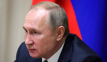 Russian President Vladimir Putin chairs a meeting in the Black Sea resort of Sochi, Russia, on Monday, December 2, 2019.