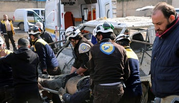 Members of the Syrian Civil Defense transporting an injured person after an airstrike hit the northern town of Maaret al-Numan, in Idlib province, Syria, on Monday, December 2, 2019.