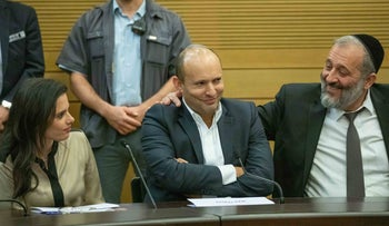Naftali Bennett, flanked by Ayelet Shaked and Arye Dery at the Knesset, November 20, 2019.
