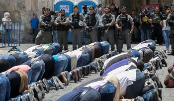 Prayer services during a protest against holding security checks at Al-Aqsa mosque in 2017.