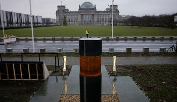 "An over-sized urn placed by the artist group 'Center for Political Beauty"" in front of German parliament building, the Reichstag, in Berlin, Germany, December 2, 2019."