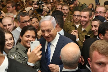 Prime Minister Benjamin Netanyahu with a group of lone soldiers in Tel Aviv, January 2019.