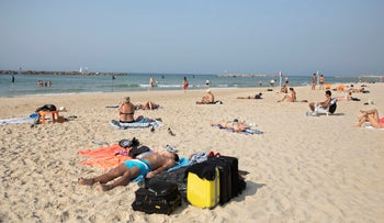 Tel Aviv beach goers enjoy unseasonably warm weather, November 10, 2019.