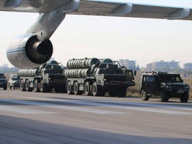 Russia's S-400 air defense missile systems standing at an airfield at the Hmeimim airbase in the Syrian province of Latakia, November 26, 2015.